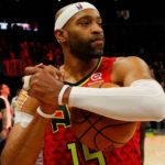 Vince Carter holding a basketball
