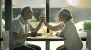 Elderly couple shares some food at Jollibee